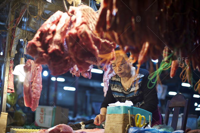 Siem Reap, Cambodia - December 21, 2014: Woman selling meat at a market