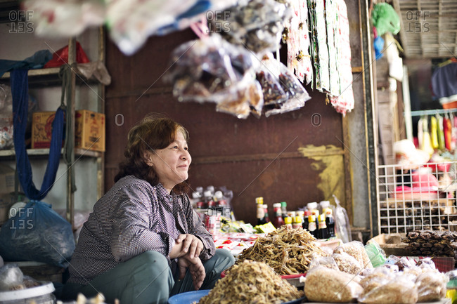 Siem Reap, Cambodia - December 21, 2014: Woman selling dried food at a market
