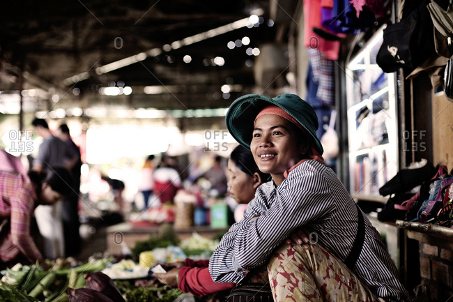 Siem Reap, Cambodia - December 21, 2014: Portrait of a vendor at a market