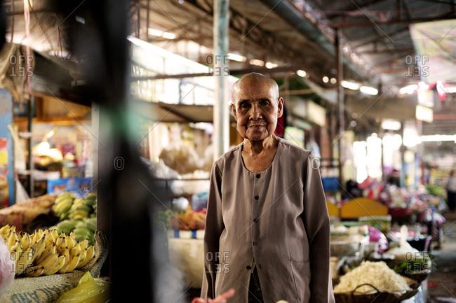 Siem Reap, Cambodia - December 21, 2014: Portrait of an elderly woman at a market