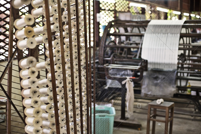 Spools of silk in a factory