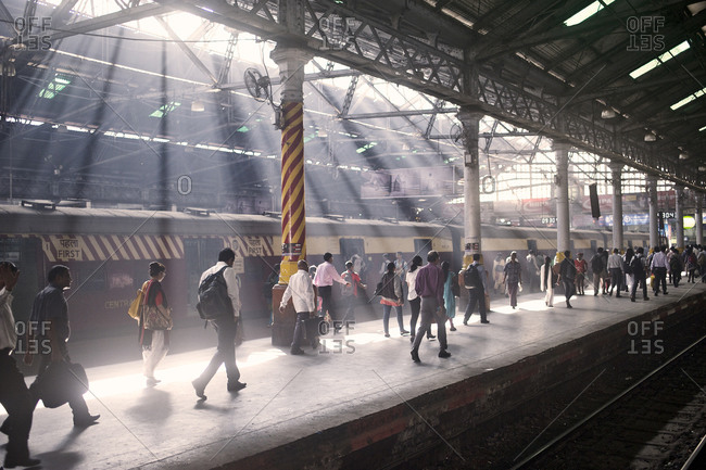 Mumbai, India - February 4, 2015: Commuters on a platform of a train station