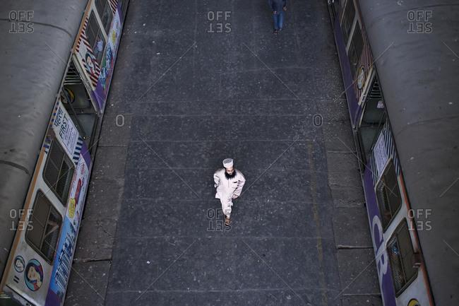 Mumbai, India - February 4, 2015: High angle view of man walking at a train station