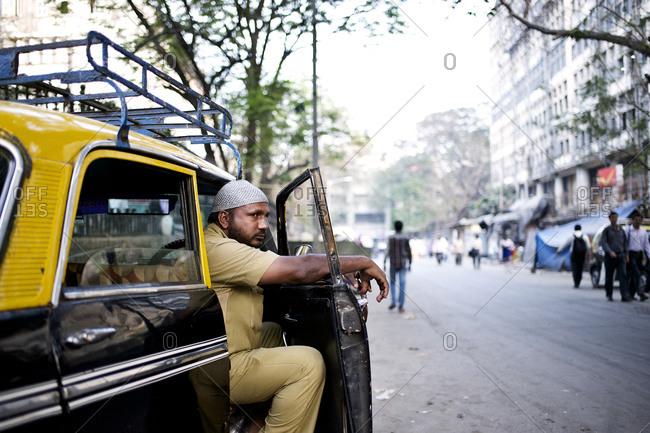 Mumbai, India - February 4, 2015: Cab driver waiting for a costumer