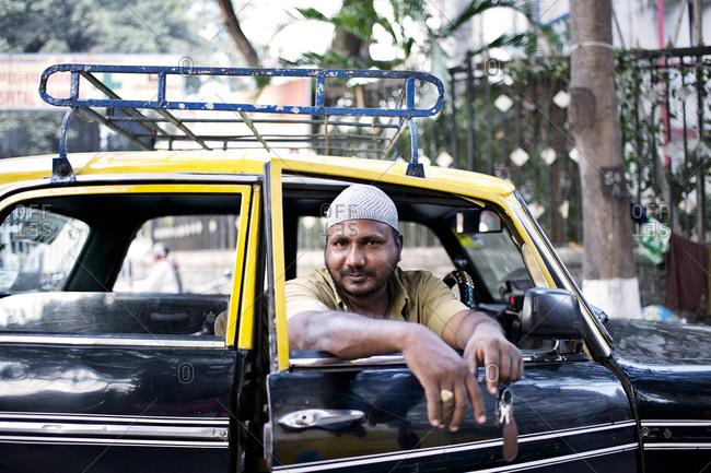 Mumbai, India - February 4, 2015: Portrait of a cab driver