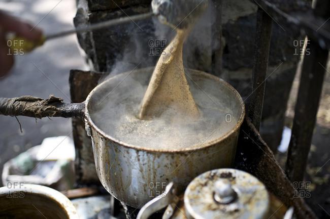 Preparing masala chai tea