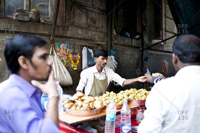 Mumbai, India - February 6, 2015: Vendor selling food at a market