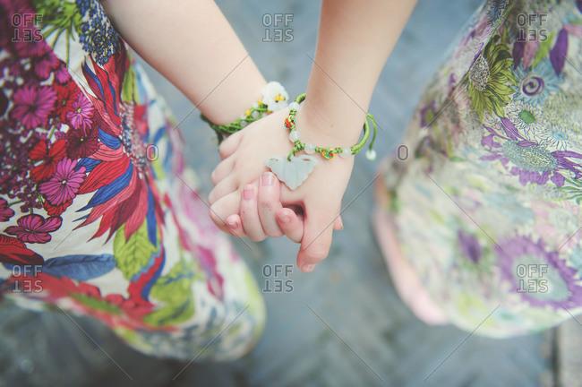 Little girls' hands with jade bracelets