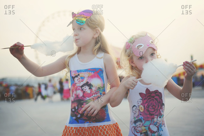 Two girls eating cotton candy