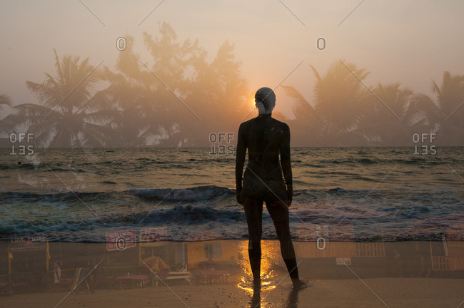 Outline of woman's silhouette against tropical scenes