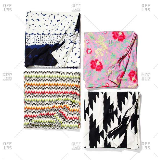 Patterned folded squares of cloth