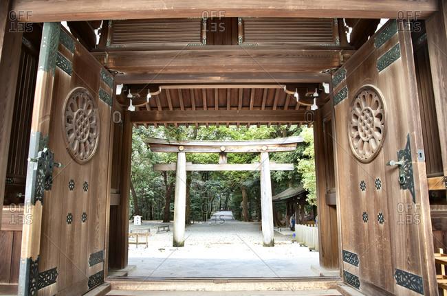 Tori gate through doors of the Meiji Shrine in Shibuya, Tokyo, Japan