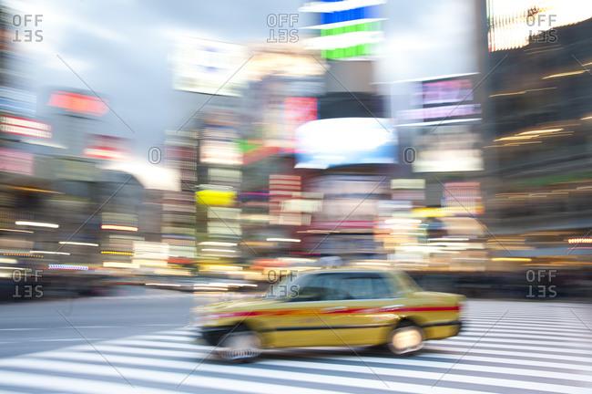 Blurred taxi at Shibuya Crossing, Tokyo, Japan