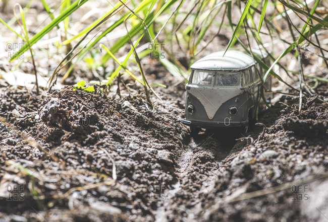 Small metal toy transporter van in nature