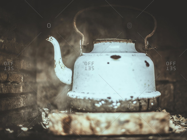 Old kettle at fireplace