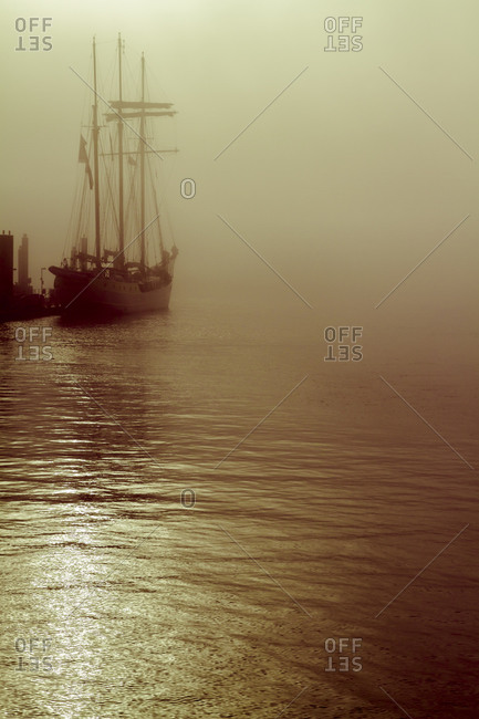 Sailing ship in fog