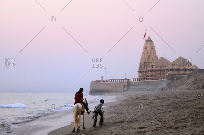 Locals on the beach at the Somnath Temple, Gujarat, India