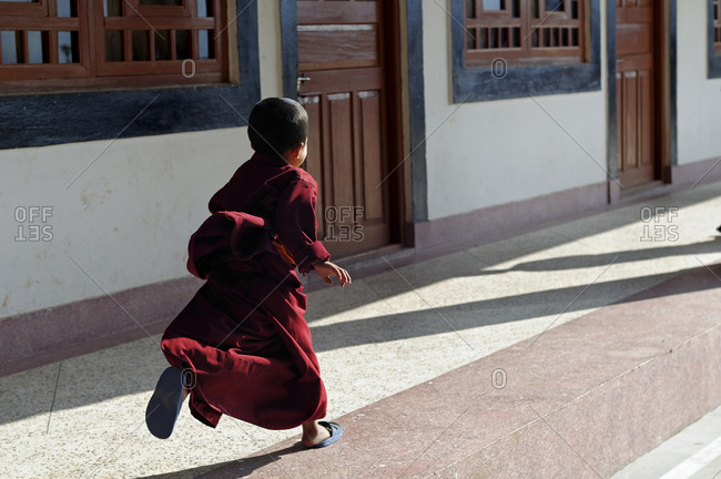 Young monk running on the street in Gangtok, Sikkim, India