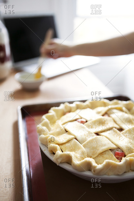 Unbaked rhubarb pie on a baking tray
