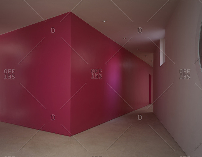 London, England, United Kingdom - May 25, 2005: Pink painted walls and concrete floors in minimal home