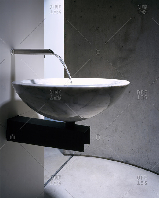London, England, United Kingdom - August 20, 2012: Modern bowl washbasin with chrome tap fitting