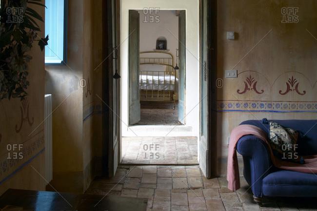 La Colombaia (Farmhouse), Tuscany, Italy - November 27, 2008: Living room and bedroom interior of Tuscan farmhouse