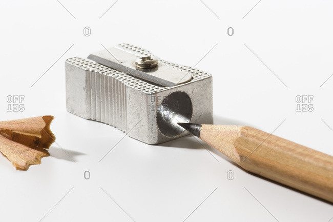 Pencil sharpener and pencil with shaving