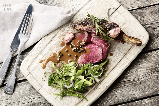 A meat dish on carving board