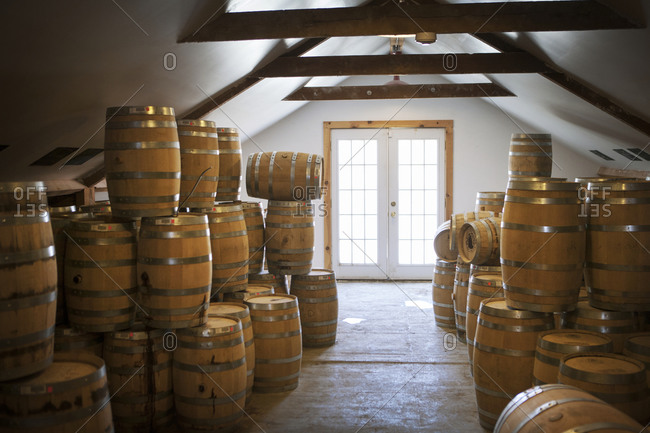 Barrels of aging whisky at a distillery