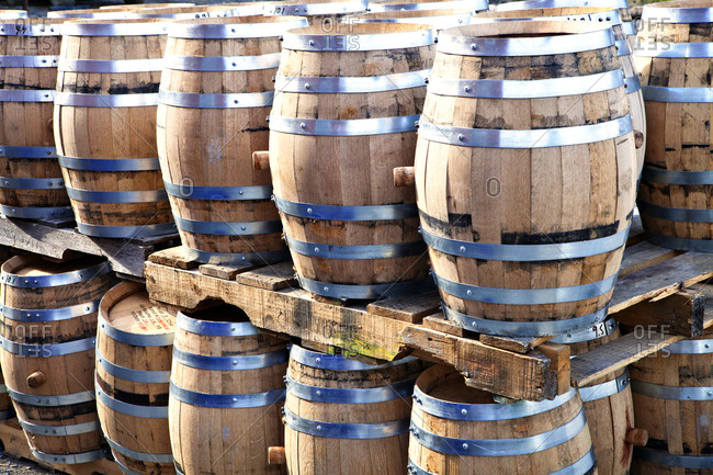 Whiskey barrels stacked on pallets