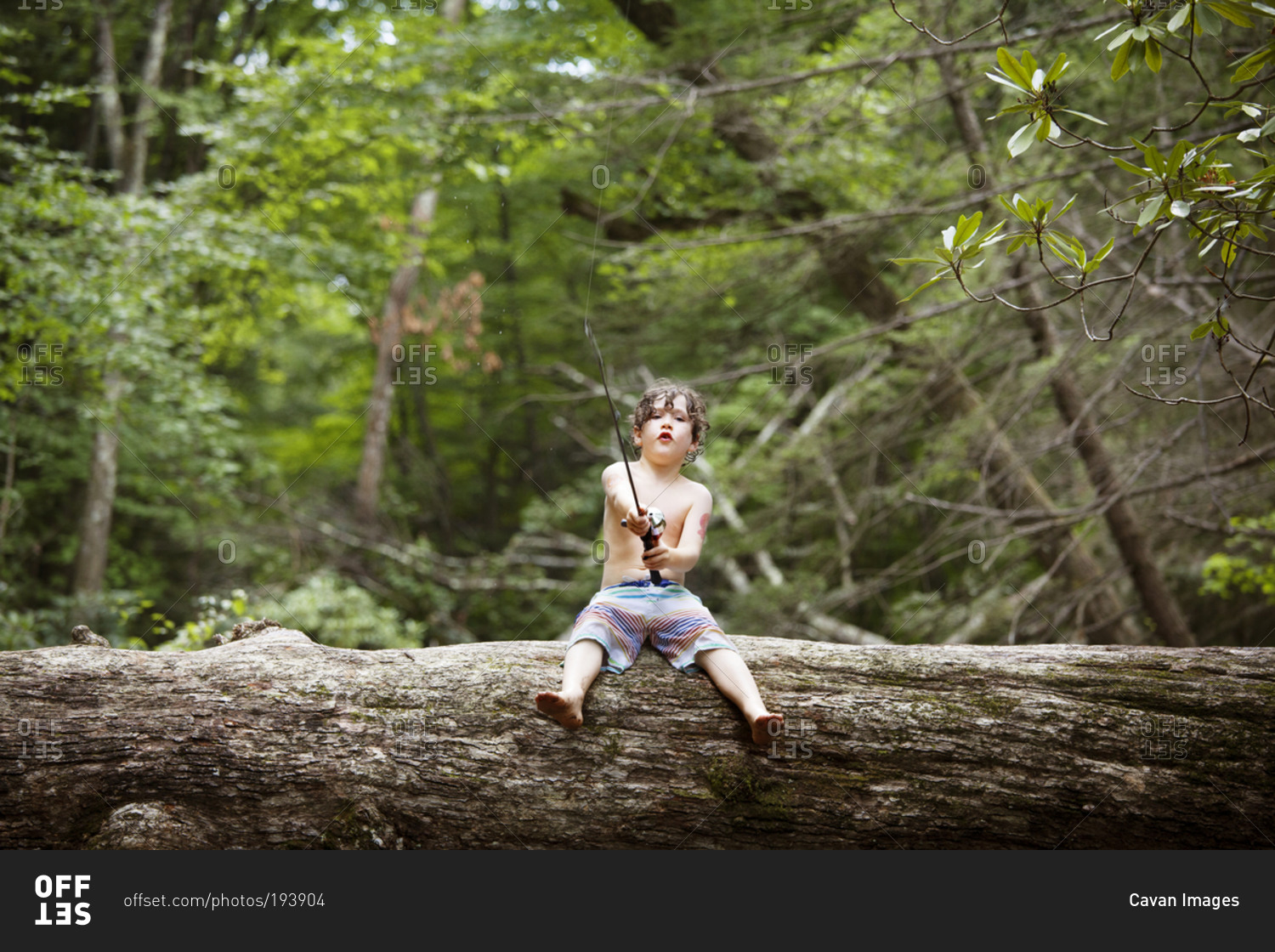 A little boy fishing on a log stock photo offset for Little boy fishing