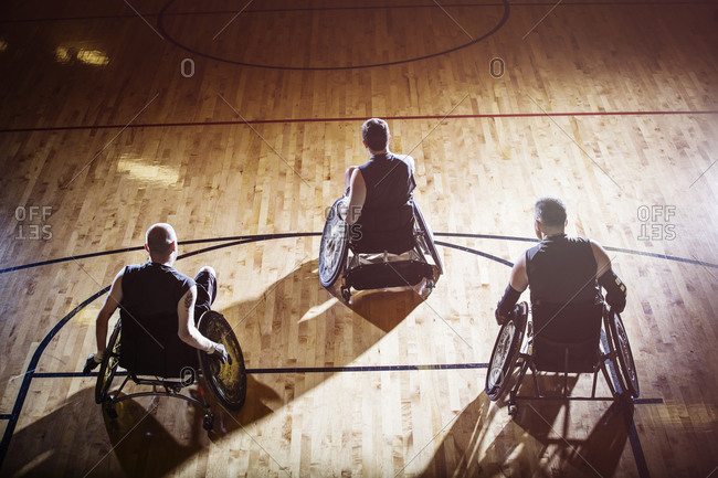 A team of wheelchair rugby players