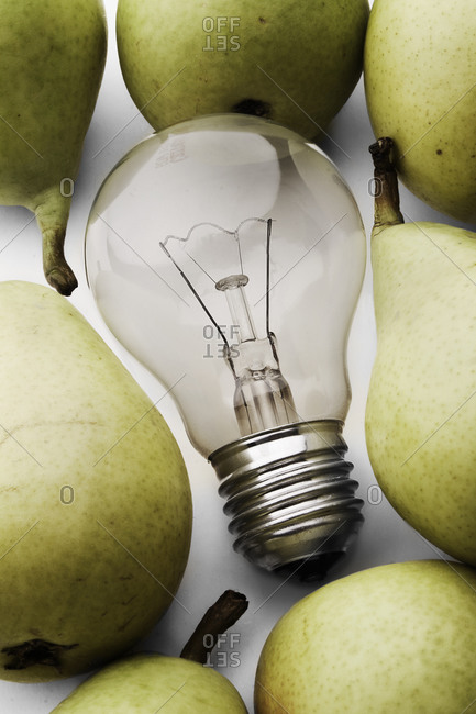 Pears and light bulb on white background