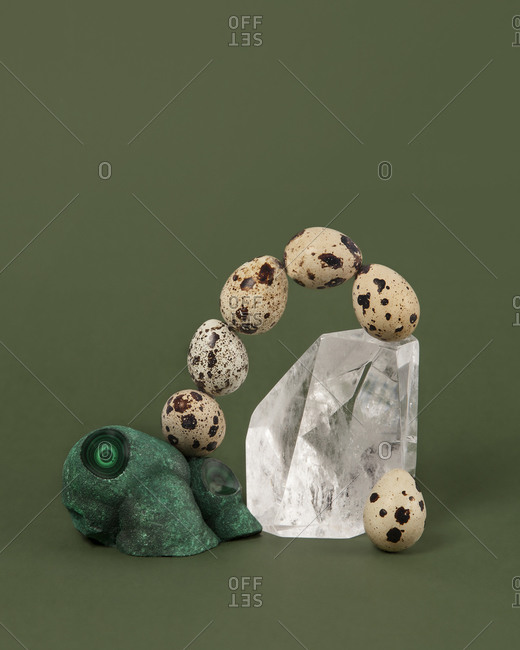 Speckled eggs in arch on minerals