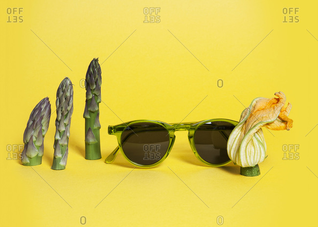 Sunglasses, asparagus tips and flowered zucchini end