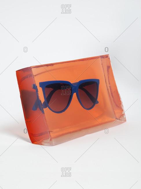 Pair of sunglasses in block of ice