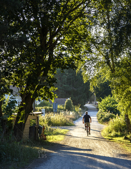 Man cycling around Koster Islands, Vastra Gotaland region, Sweden