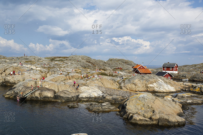 Sweden - July 21, 2014: People relaxing on rocky coast of Weather Islands, Sweden