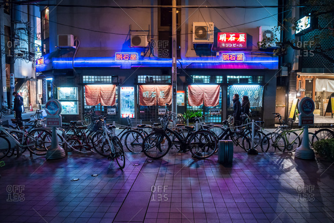 Osaka, Japan - February 20, 2015: Asian shop with bikes parked out front