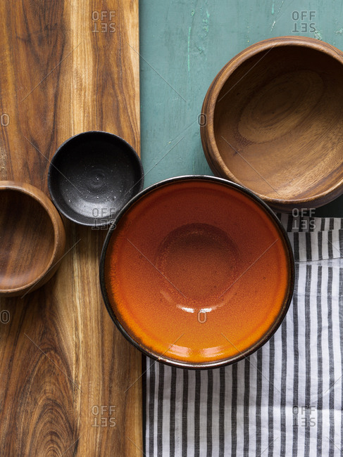 Pottery and wooden bowls arranged on a tabletop