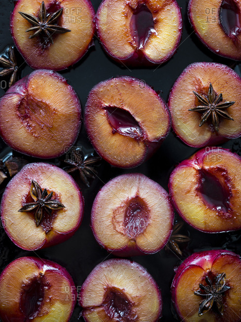 Sliced plums with star anise