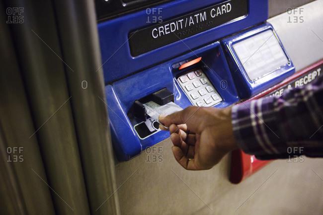 Man using credit card at transit card machine