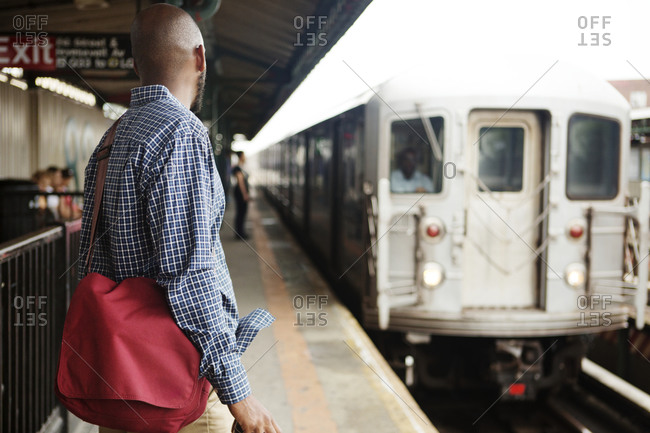 Commuters waiting on platform for train