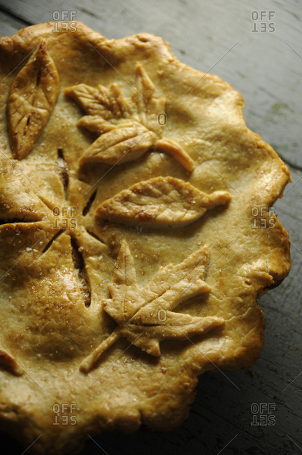 A rustic pie decorated with leaves made from pie crust