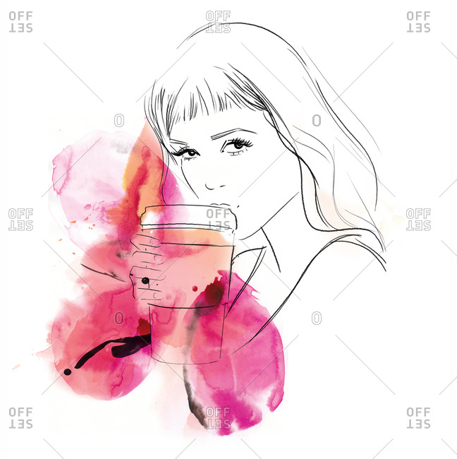 A woman drinking coffee in a to-go cup