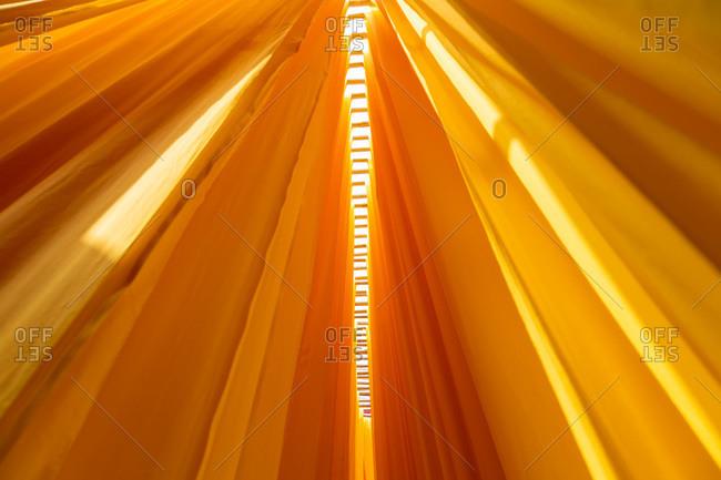 Orange textiles in a sari factory