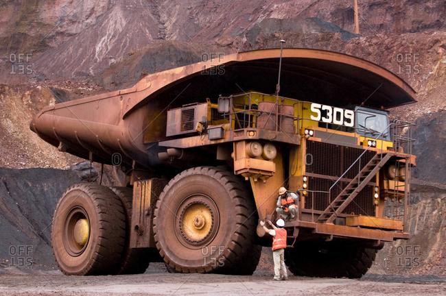 A giant dump truck in a quarry