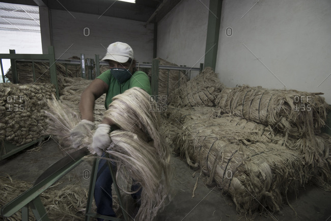 A woman works in a yarn production plant