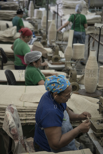 Manaus, Amazonas, Norte, Brazil - June 28, 2013: Women in a factory sewing jute sacks