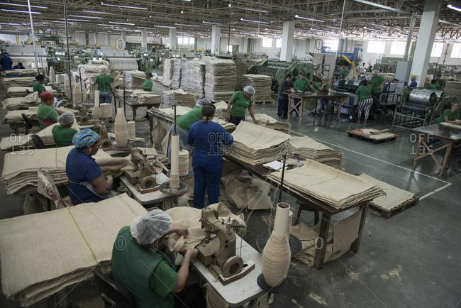 Manaus, Amazonas, Norte, Brazil - June 28, 2013: Women sewing jute sacks